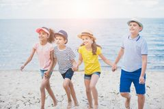 multicultural kids holding hands while walking stock photography