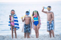 multicultural kids in swimming masks with water toys in hands stock photo