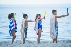 multicultural kids in swimming masks with water toys in hands stock photos