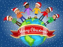Multicultural kids xmas hat singing Christmas carol hand Earth Royalty Free Stock Photo
