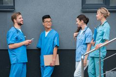 Multicultural male and female medical students looking at each other. At medical university royalty free stock images