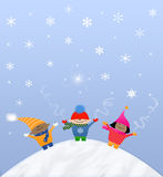 Multicultural Snow kids. Multicultural children playing in the falling snow Stock Photo