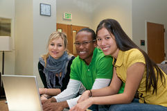 Multicultural Students in Student lounge. Diverse ethnic Students on university campus. A photo of Asian, African American and Caucasian students Stock Images