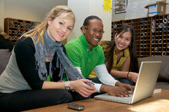 Multicultural Students in Student lounge. Diverse ethnic Students on university campus. A photo of Asian, African American and Caucasian students Royalty Free Stock Photography