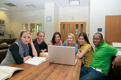 Multicultural Students in Student lounge. Diverse ethnic Students on university campus. A group of Asian, African American, Hispanic and Caucasian students Stock Image