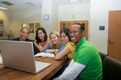 Multicultural Students in Student lounge. Diverse ethnic Students on university campus. A group of Asian, African American, Hispanic and Caucasian students Royalty Free Stock Images