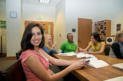 Multicultural Students in Student lounge. Diverse ethnic Students on university campus. A group of Asian, African American, Hispanic and Caucasian students royalty free stock photo