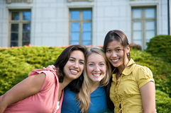 Multicultural Students on University Campus. Diverse ethnic Students on university campus. A photo of Asian, Hispanic and Caucasian students stock photo