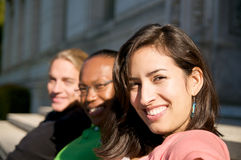 Multicultural Students on University Campus. Diverse ethnic Students on university campus. A photo of African American, Hispanic and Caucasian students Stock Image