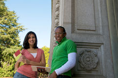 Multicultural Students on University campus. Diverse ethnic Students on university campus. A photo of African American and Hispanic students Stock Images