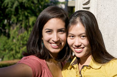 Multicultural Students on University Campus. Diverse ethnic Students on university campus. A photo of Asian and Hispanic students stock photos