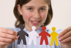 Multicultural team. Teenager with multicolor paper people Royalty Free Stock Photo