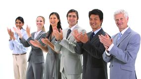 Multicultural team applauding Royalty Free Stock Image