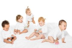 group of adorable multicultural toddlers with cash and credit cards stock images