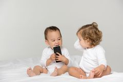 multicultural toddlers with digital smartphone stock photos