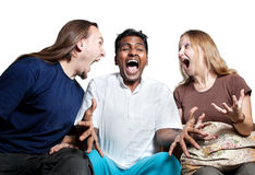 Multicultural Tree people screaming. Tree people: Caucasian couple woman and man screaming at Indian man at white background royalty free stock photo