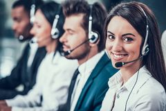 Multicultural young happy employees in call center stock photography