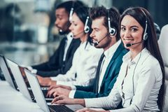 Multicultural young happy employees in call center stock photos