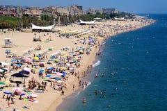 Multidão da praia de Calella Imagens de Stock Royalty Free