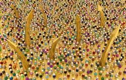 Multidão dos desenhos animados, elevação dourada Fotografia de Stock