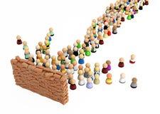 Multidão dos desenhos animados, parede de tijolo Fotos de Stock