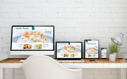 Multidevice desktop healthy recipes. Multidevice desktop with healthy recipes website on screens. 3d rendering Stock Images