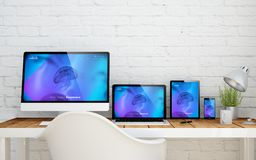 Multidevice desktop rwd. Multidevice desktop with responsive website on screens. 3d rendering Royalty Free Stock Image