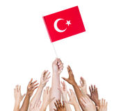 Multiethnic Arms Raised for the Flag of Turkey.  royalty free stock image