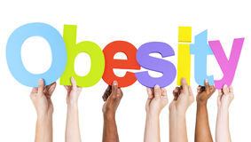 Multiethnic Arms Raised Holding Text Obesity Royalty Free Stock Images