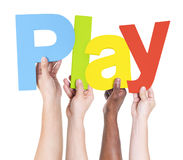 Free Multiethnic Arms Raised Holding Text Play Royalty Free Stock Image - 41013786