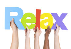 Multiethnic Arms Raised Holding Text Relax Royalty Free Stock Photos