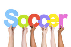 Multiethnic Arms Raised Holding Text Soccer Royalty Free Stock Photos