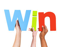 Multiethnic Arms Raised Holding Text Win Stock Photography