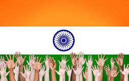 Multiethnic Arms Raised Up on an Indian Flag Royalty Free Stock Photos