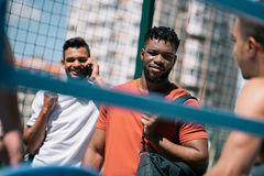 Multiethnic athletic men standing on stadium before training Royalty Free Stock Photography