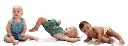 Multiethnic babies. Dancing on light background stock image