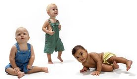 Multiethnic babies. Dancing on light background royalty free stock photo