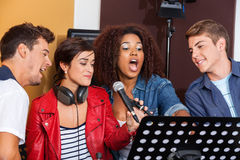 Multiethnic Band Members Performing Together stock photo