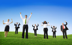 Multiethnic Business People Arms Raised Outdoors Stock Photo