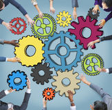 Multiethnic Business People with Cog Symbols Stock Image