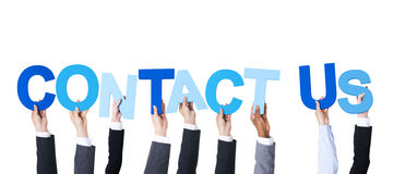 Multiethnic Business People Holding Contact Us Stock Photos