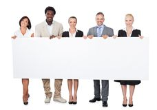 Multiethnic business people holding large billboard Stock Photos