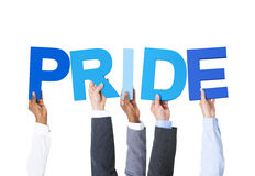 Multiethnic Business People Holding Word Pride.  royalty free stock image