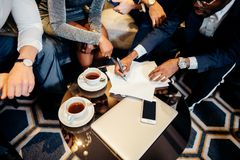 Business people meeting in office top view. Multiethnic Business people meeting in office top view Stock Images