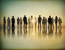 Multiethnic Business People in a Row Looking at Sunlight Stock Image