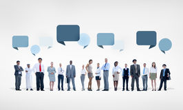 Multiethnic Business People in a Row with Speech Bubbles Above Royalty Free Stock Images