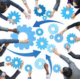 Multiethnic Business People with Teamwork Symbols Royalty Free Stock Images