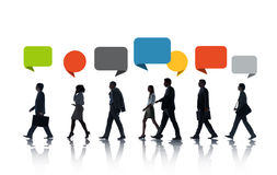 Multiethnic Business People Walking in a Row with Speech Bubble Stock Photography