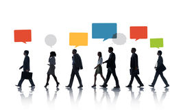 Multiethnic Business People Walking in a Row with Speech Bubble Royalty Free Stock Images