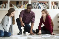 Multiethnic business team collaborating on project together. royalty free stock photos
